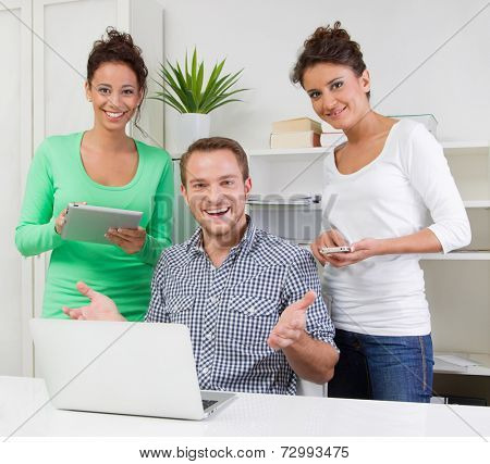 Three people working together in office