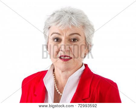 Isolated portrait of attractive senior businesswoman in red jacket over white background.