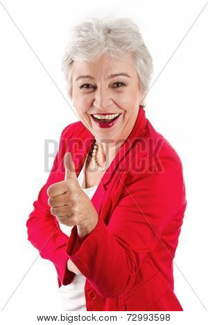 Happy senior businesswoman with thumbs up
