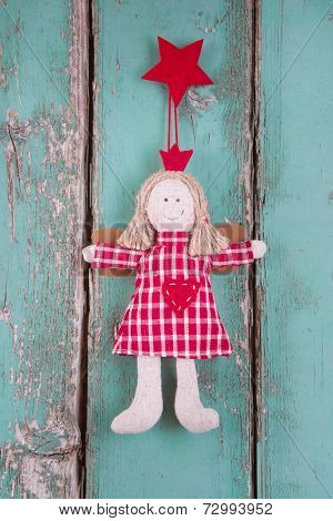 Sewn angel doll hanging