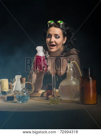 Alchemist girl with test tubes