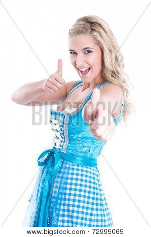 Blond woman showing all right with her hand wearing a blue checked bavarian dress.