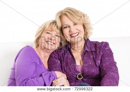 Two older women smiling - sisters or old girlfriends