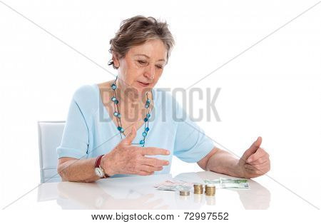 Sad old woman isolated over white - poorness in the age. Collecting her money and calculate.