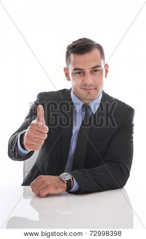 Attractive business man facing camera : thumb up isolated on white background
