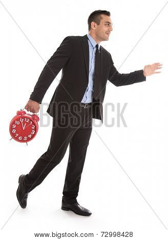 Business man in time: walking to the right holding clock isolated on white background