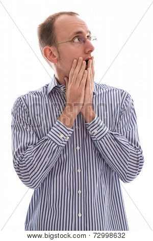 Surprised man looking up over his shoulder with his hands covering his mouth isolated on white background