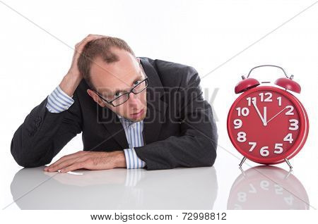 Businessman overworked with red clock isolated on white background
