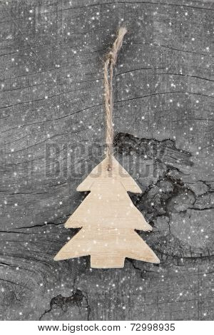 Wooden tree - christmas decoration country style or shabby chic - natural snowy background
