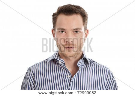 Attractive young man in blue shirt staring at camera