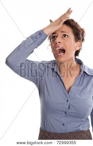 Business pressure: frustrated pretty young woman in blue blouse is shouting and touching her head isolated on white background