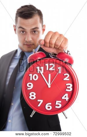 Time is money: businessman holding close up of red alarm clock isolated on white background - deadline or concept for change management