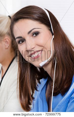 Telesales or helpdesk - happy pretty woman in blue with headset