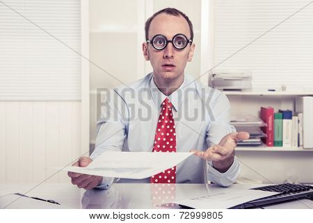 Businessman - hard sell or perplexed handing paper over - stressed man at work