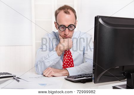Frustrated man with burn-out syndrome - sad sitting at his table and thinking about his problems.