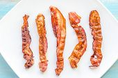stock photo of bacon strips  - Fried Bacon Strips On The Square Plate - JPG