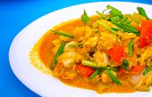 picture of blue crab  - Closeup Fried crab in curry on blue table Thai food - JPG
