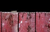 stock photo of red siding  - Brownish-grey grasshopper perched upon a rustic red & gray weathered barn door.
