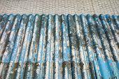 picture of asbestos  - Corrugated blue asbestos ceiling panels - JPG