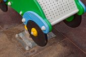 picture of baby spider  - Wooden baby car on one spring on kids playground - JPG