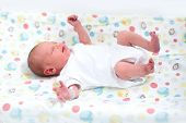 stock photo of diaper change  - Tiny Newborn Baby On A Changing Table - JPG