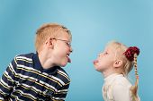 picture of long tongue  - Teenage boy and girl stick out tongues to each other - JPG