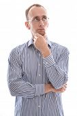 foto of disadvantage  - Man with glasses touching chin and disappointed isolated on white background - JPG