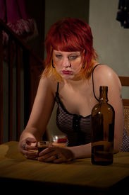 picture of underage  - Underage alcoholic woman with bottle of wine - JPG
