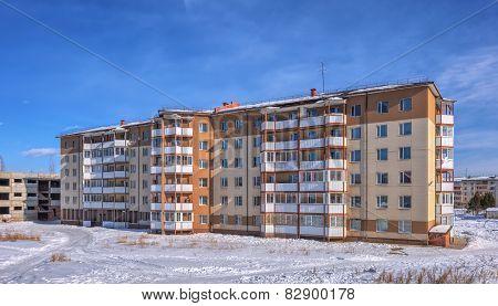 :SAYANSK, IRKUTSK/RUSSIA - FEBRUARY 15, 2015: A six-story apartment building in the Siberian