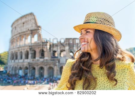 Portrait Of Happy Young Woman In Front Of Colosseum In Rome, Ita