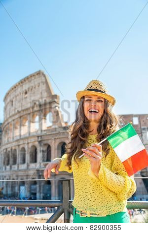 Portrait Of Happy Young Woman With Italian Flag In Front Of Colo