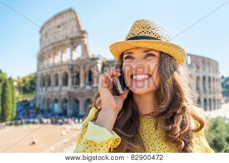 Portrait Of Happy Young Woman Talking Mobile Phone In Front Of C