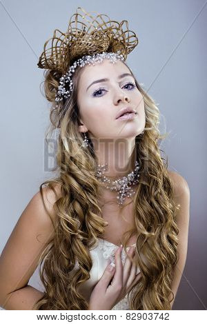 beauty young snow queen with hair crown on her head