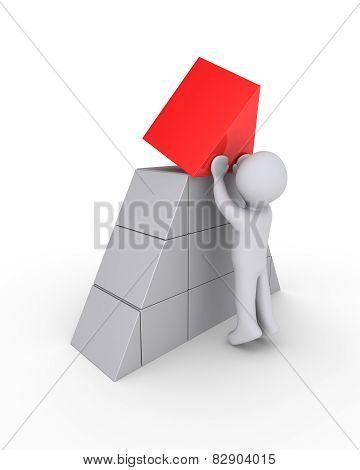Person Finalizing Pyramid