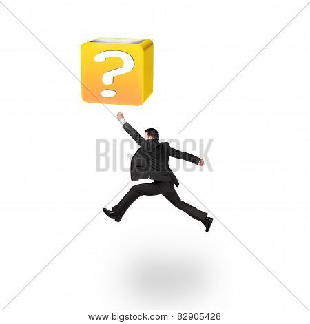 Jumping Businessman Hitting 3D Question Mark Box Isolated On White