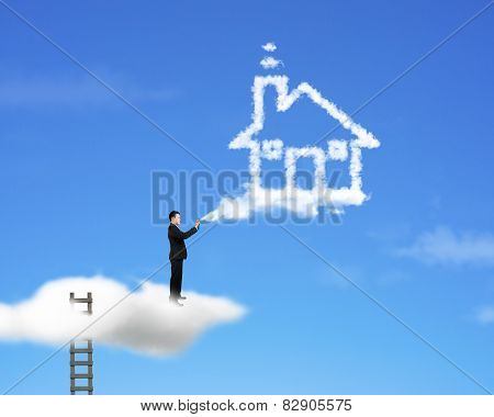 Businessman Spraying House Shape Cloud Paint With Ladder And Sky