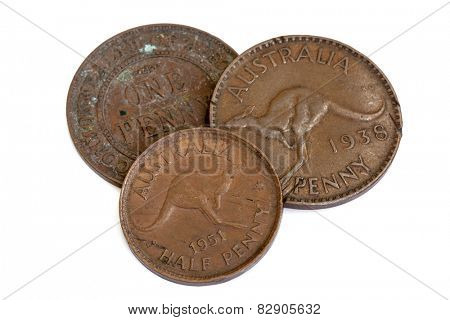 Three old Australian pennies, isolated on white background.
