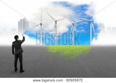Businessman Spraying Wind Turbines Paint Covered Gray Cityscape