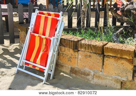Folding Metal Chair On The Sea Beach