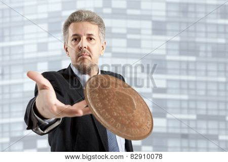 Close up of businessman throws a coin