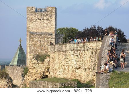 BELGRADE, SERBIA - JULY 29, 2014: young people crowding the defensive walls of Kalemegdan Fortress in Old Town Belgrade. Shot in 2014