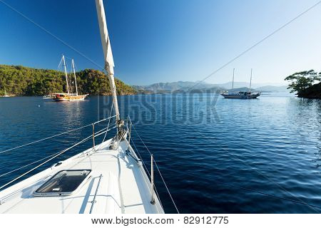 Sailing vessel anchored in calm bay. Aegean Sea, Turkey