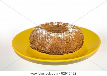 Bunt cake on a yellow plate