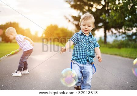 Little boys playing outside the house