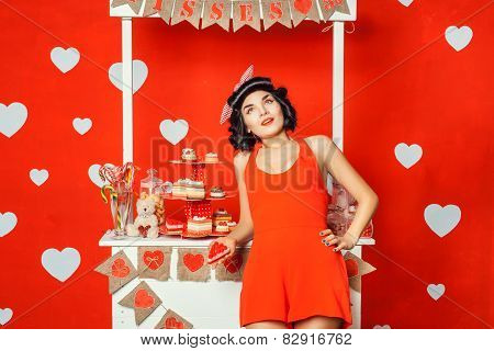 Woman In Red Dress Holding A Cake And Dreams.