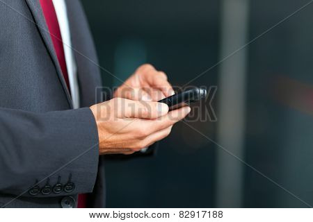 Closeup of a man using mobile phone