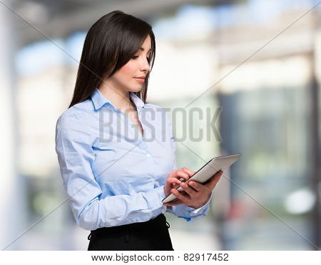 Portrait of a woman using a tablet