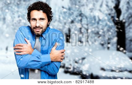 Portrait of a freezing businessman outdoor