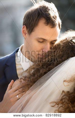 Handsome Young Groom Hugging Bride Tenderly