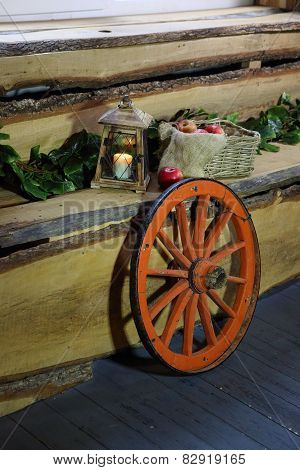 Apples In A Wattled Basket Both An Old Lantern And A Wheel